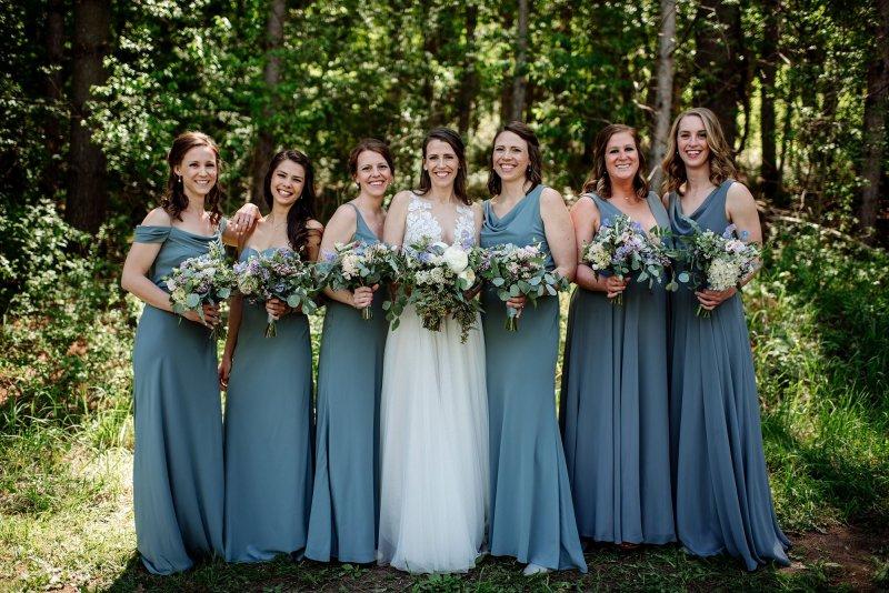 bridesmaids laughing wedding at round barn