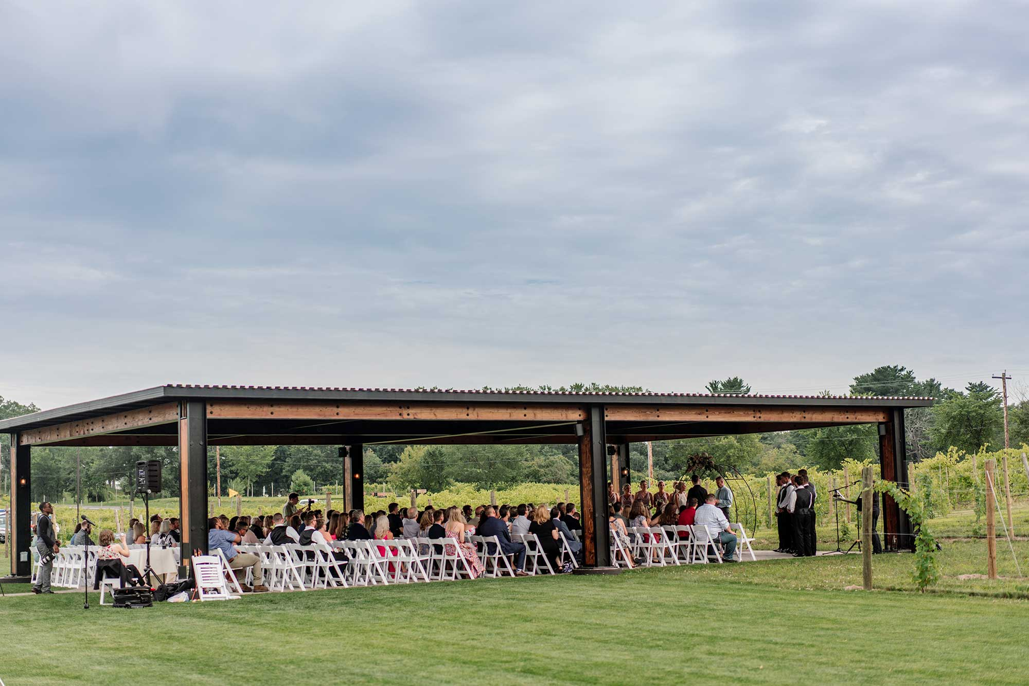 wedding ceremony outside at 7 vines vinyard wedding mn