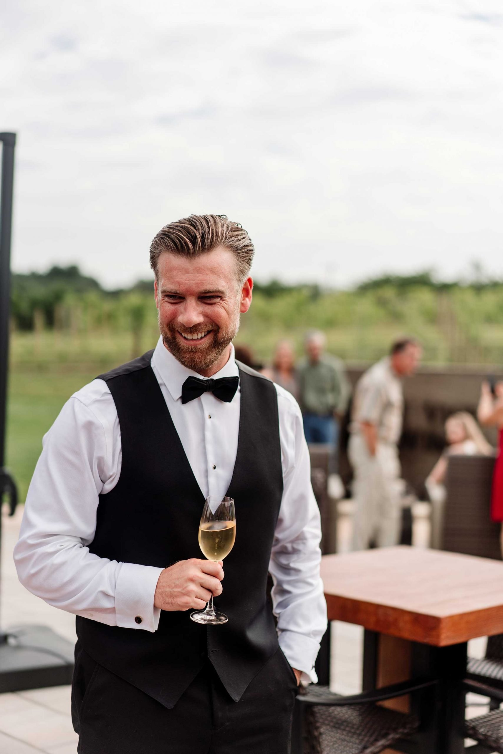 groom laughs during cocktail hour