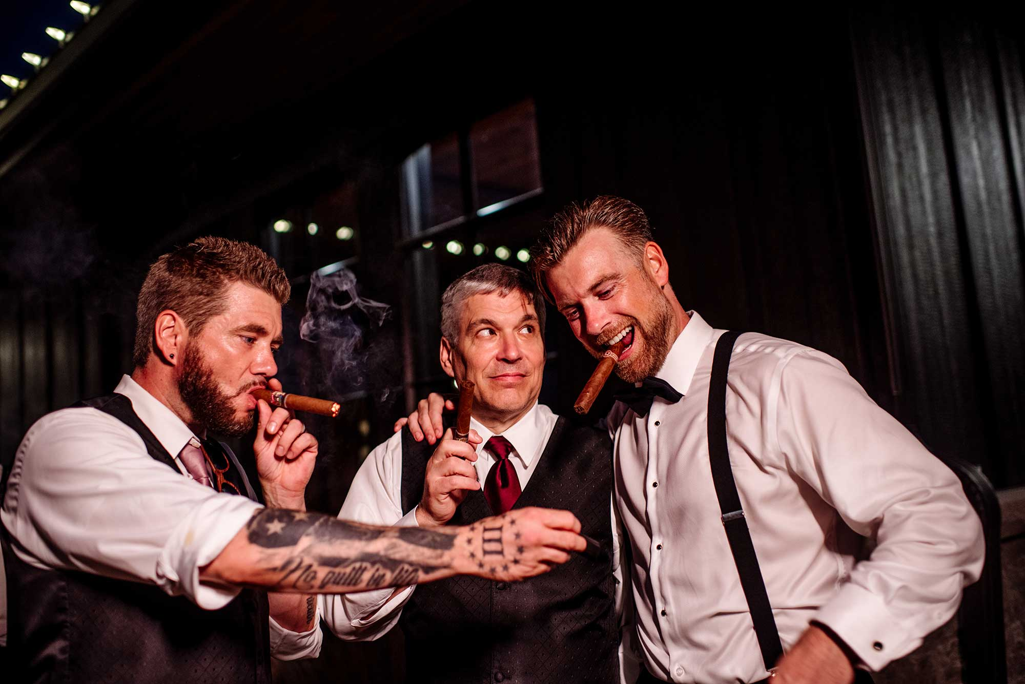 Groomsmen with cigars at end of the night at 7 vines vinyard wedding mn