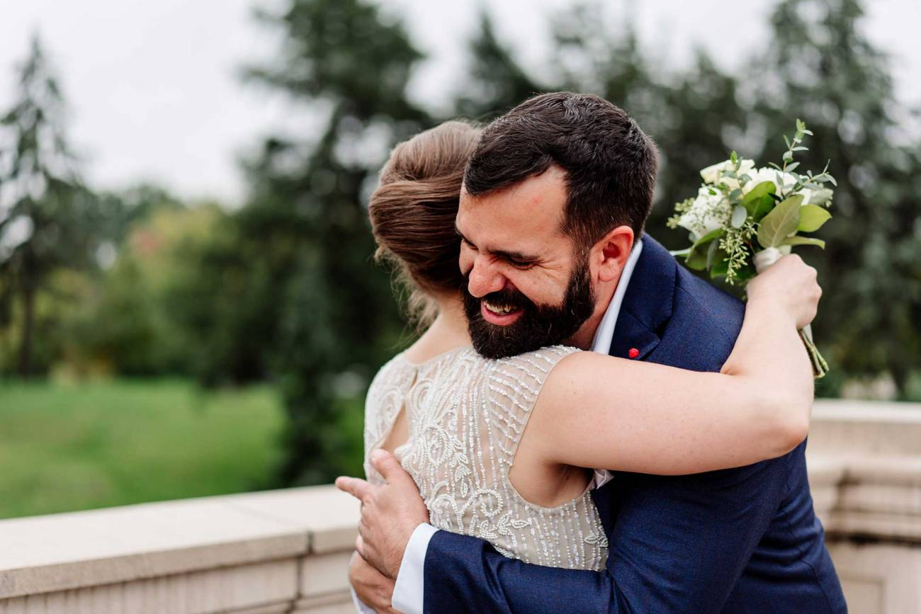 bride and groom hug after first look Como Conservatory wedding