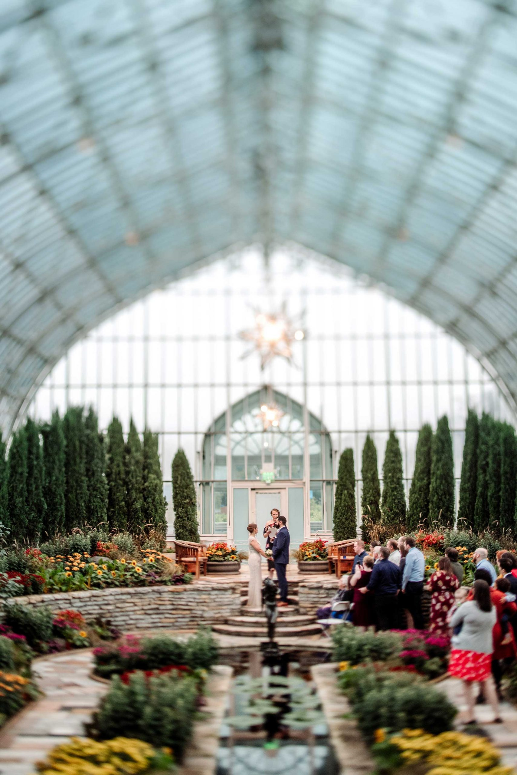 tilt shift lens photo of Como Conservatory wedding ceremony in sunken garden