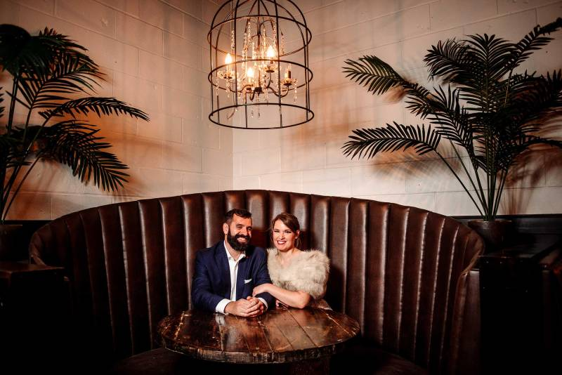 bride and groom in large booth of fitz restaurant st paul