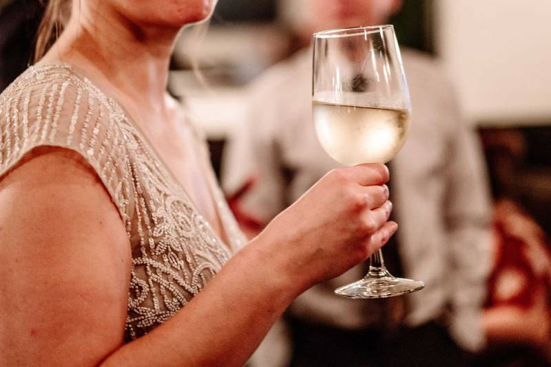 bride with glass of wine