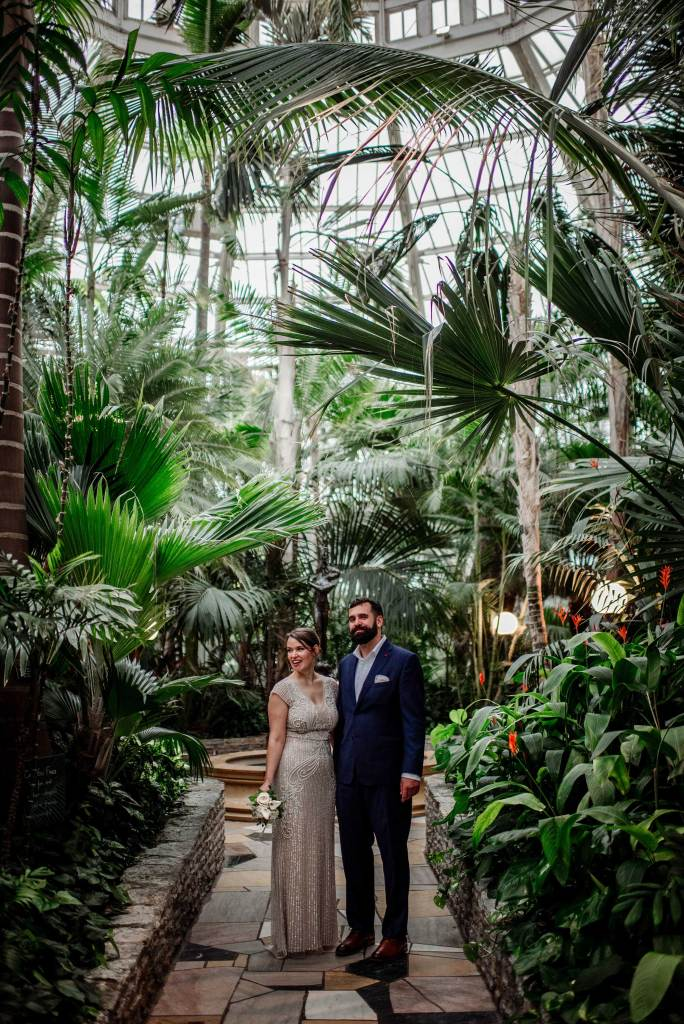 bride and groom in palm dome of Como Conservatory