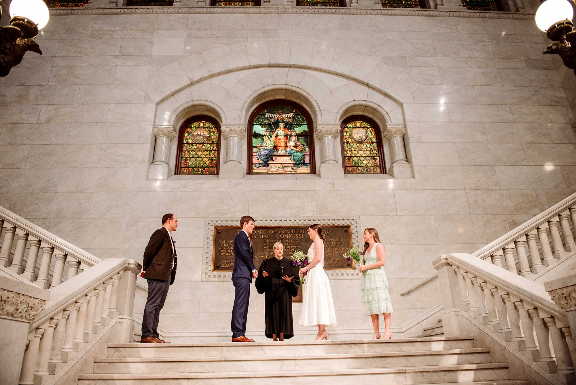 small wedding ceremony in lobby of minneapolis city hall