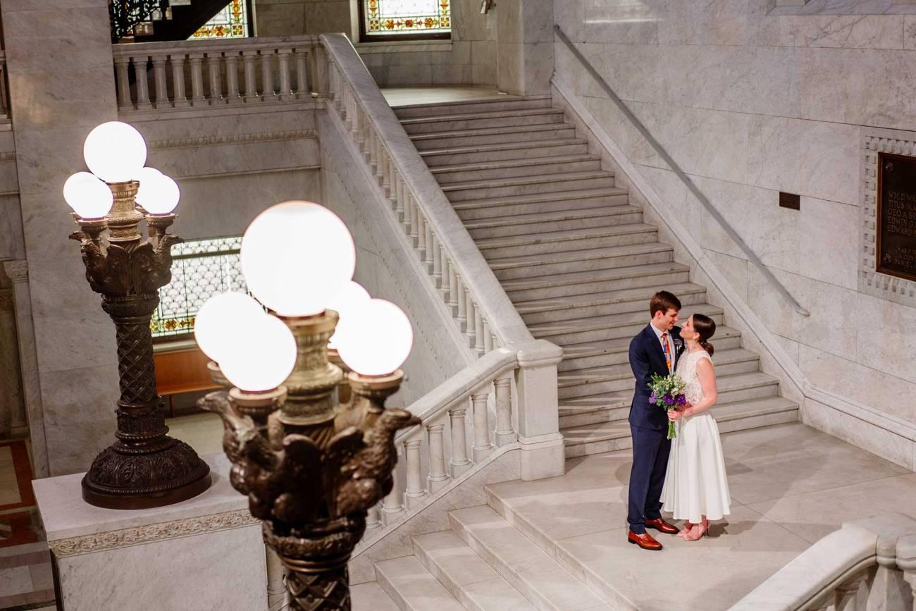 bride and groom embrace Minneapolis city hall wedding