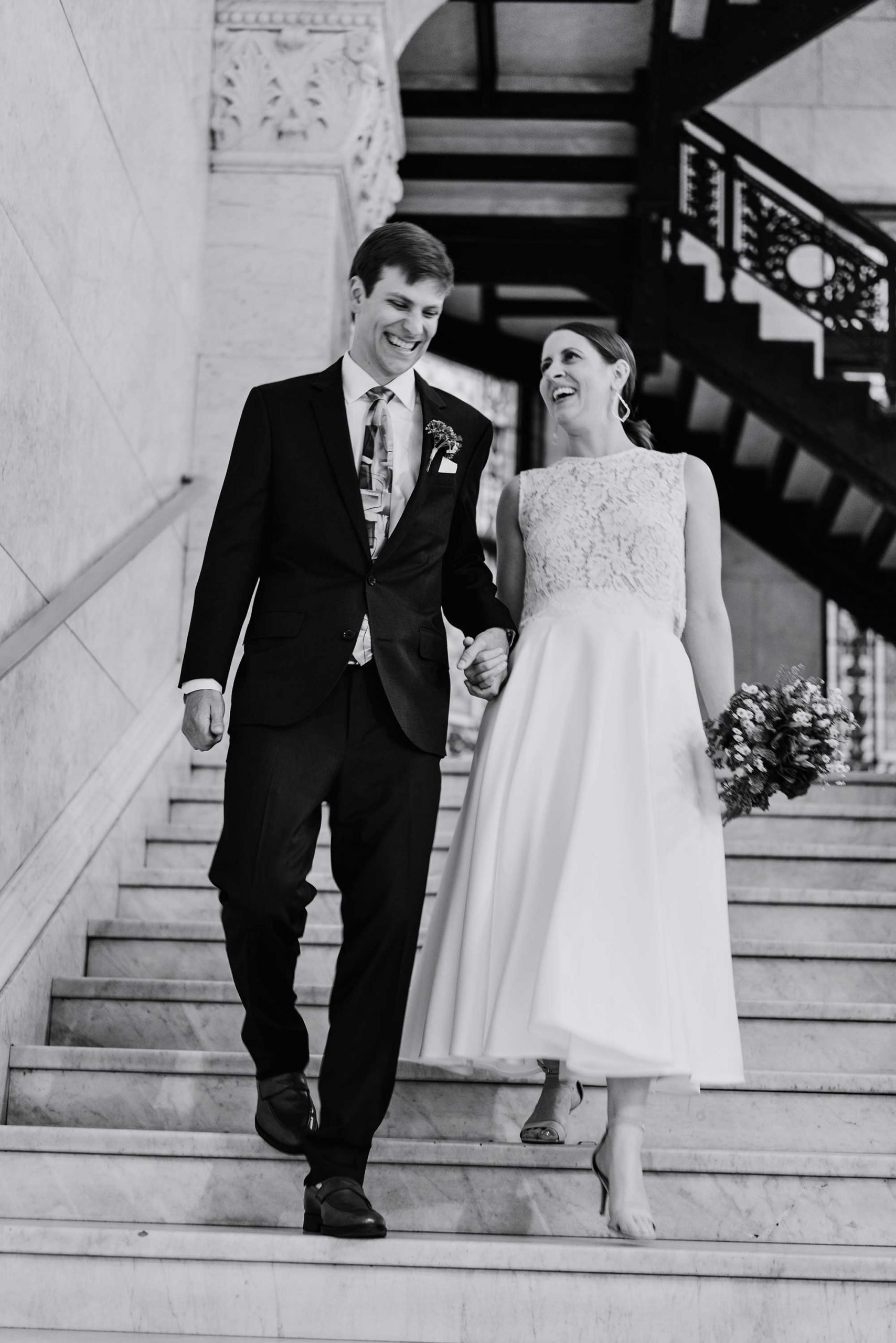 walking down the steps AT Minneapolis city hall wedding