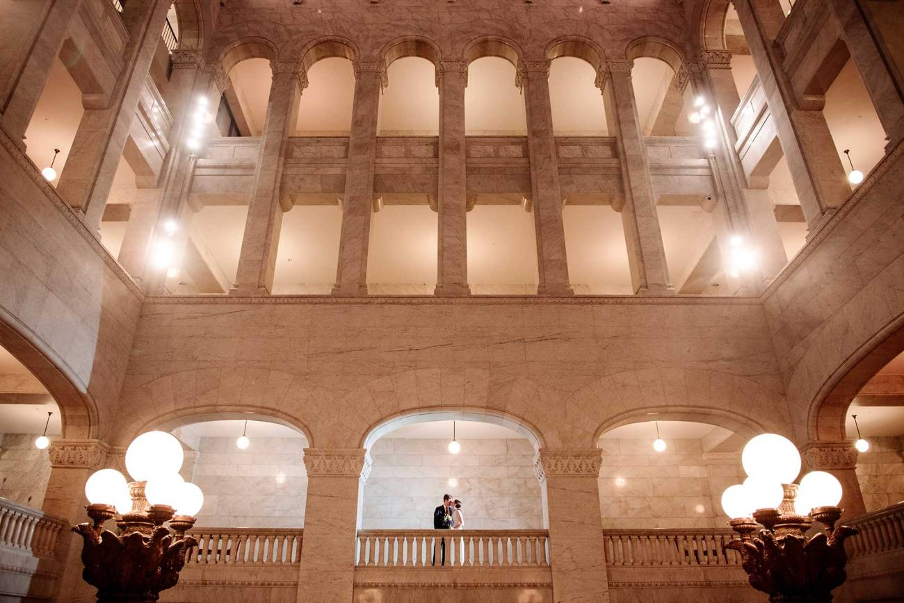 huge interior of minneapolis city hall with couple inside one window