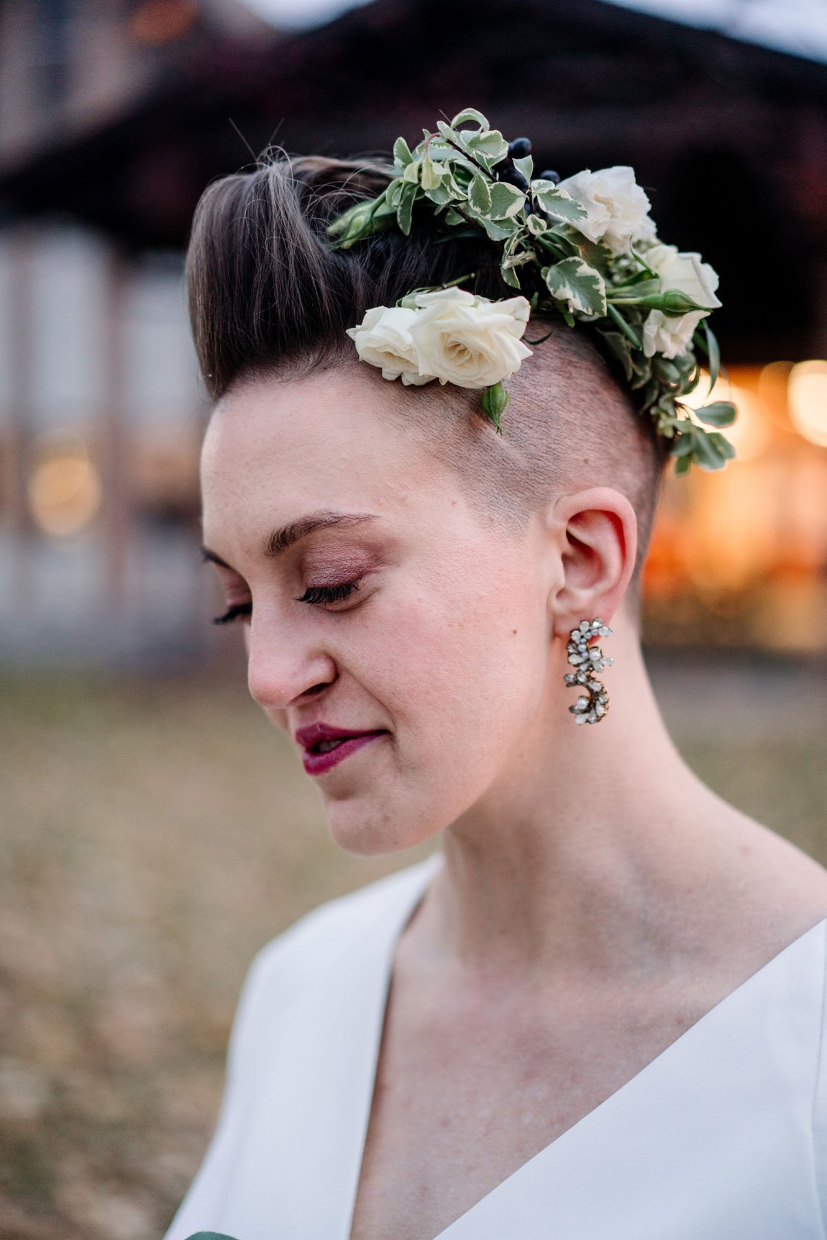 bride with shaved head and flowers in her hair for small wedding with restaurant st paul mn