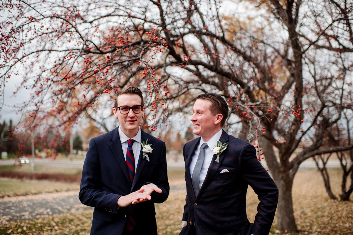 groom and his brother small wedding with restaurant st paul mn