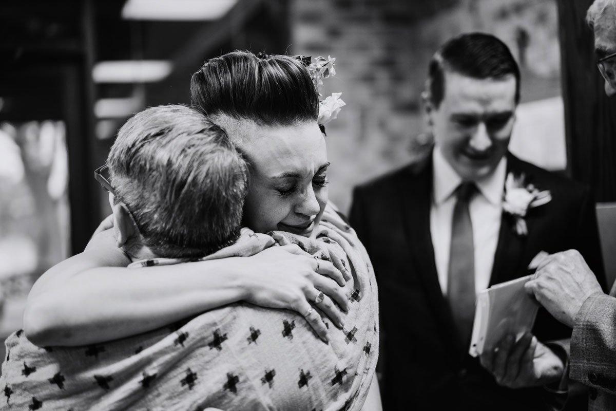 bride hugs family small wedding with restaurant st paul mn