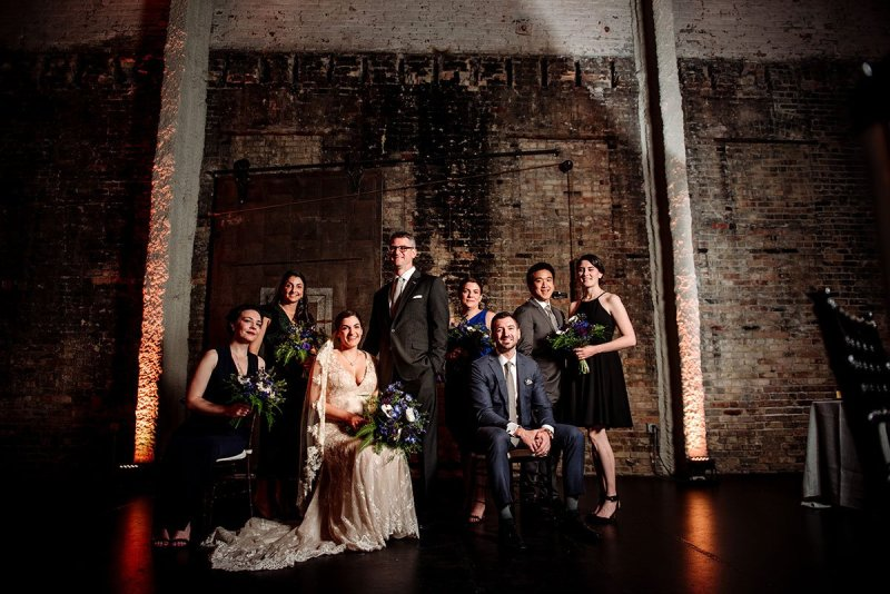 wedding party fashion grouping with dramatic lighting at aria wedding