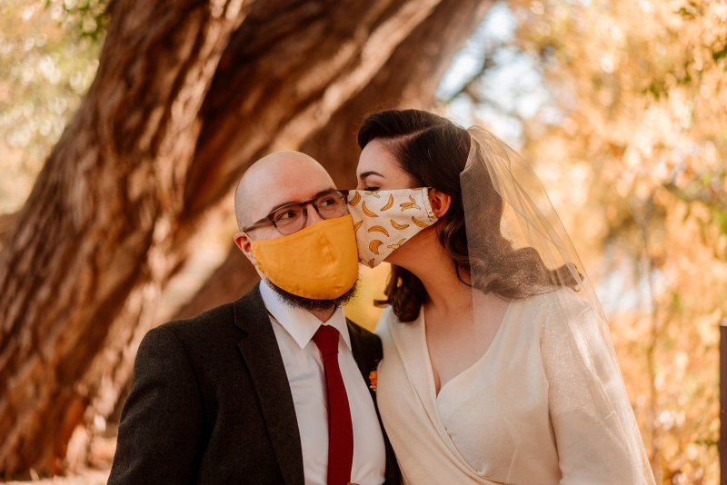 bride and groom in masks during covid Minneapolis elopement photographer