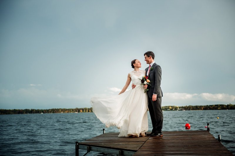 couple on dock MN wedding at Camp Miller
