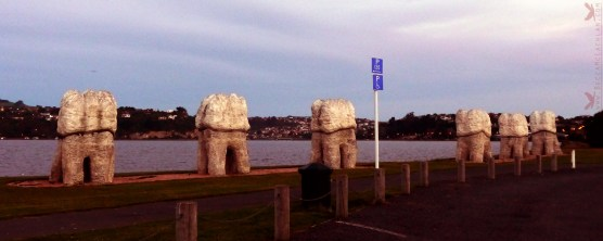 Harbour Mouth Molars, six large wisdom teeth, made from concrete and Oamaru stone, by Wellington artist Regan Gentry. Kitchener Street Park, Otago Harbour, Dunedin, New Zealand