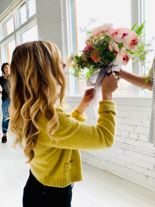 One of our lovely photographers captured this photo while I was adding my silk ribbon to Katiebug Floral's beautiful blooms!
