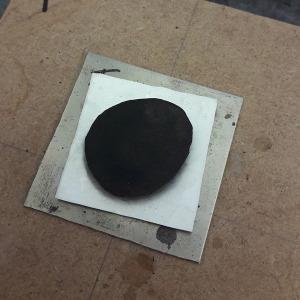 Shaped rubber on silver sheet