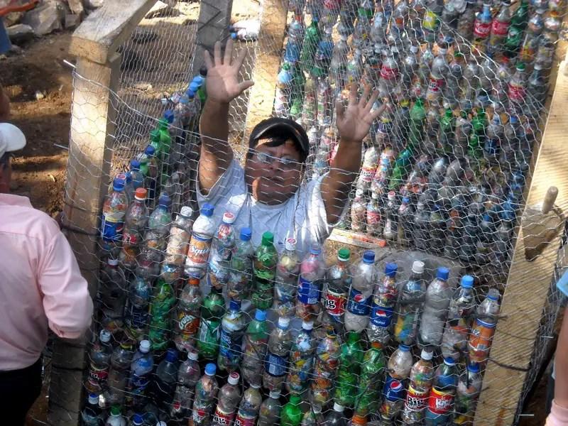 Using empty plastic pop bottles for building construction