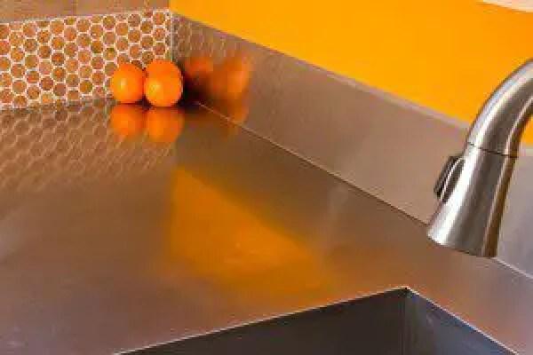 Stainless steel countertop in Kitchen, Cork tile backsplash from Jelinek cork