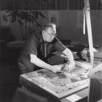 black and white photo of architect Bruce Goff working on a mosaic