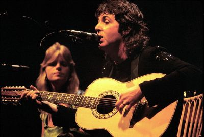 Paul and Linda McCartney performing with Wings in 1976.