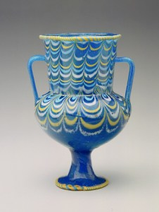 This glass jar was made in Ancient Egypt between 1539 and 1295 BCE (18th Dynasty; New Kingdom).
