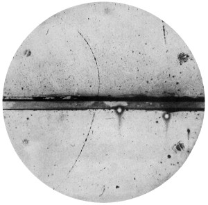 Carl Anderson's 1932 photograph of a cloud chamber showing the trail of a positron.