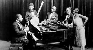 A 1926 photograph of Louis Armstrong (seated) and his Hot Five: from left, Johnny St . Cyr, Johnny Dodds , Kid Ory and Lil Hardin Armstrong.