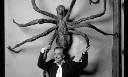 A 1996 photograph of Louise Bourgeois with her sculpture 'Spider IV.' (Photo by Peter Bellamy; courtesy of Zeitgeist Films.)