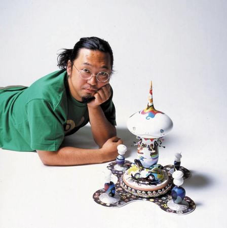 Takashi Murakami with a small version of his sculpture 'Tongari Kun - Mr. Pointy & the Four Guards' (2005).