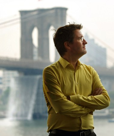 Olafur Eliasson , with one of the 'New York Waterfalls' in the background.