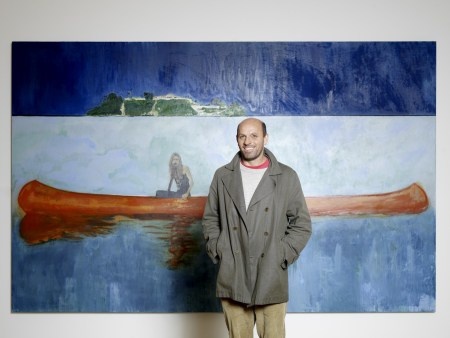 Peter Doig with a painting from the '100 Years Ago' series (2001).