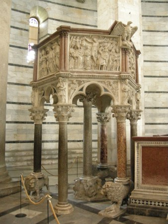 The pulpit in the Pisa Baptistery in Pisa, Italy, was carved by Nicola Pisano.