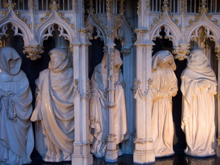 A portion of the arcade beneath the tomb of Philip the Bold showing some of the mourners carved by Claus Sluter and Claus de Werve.