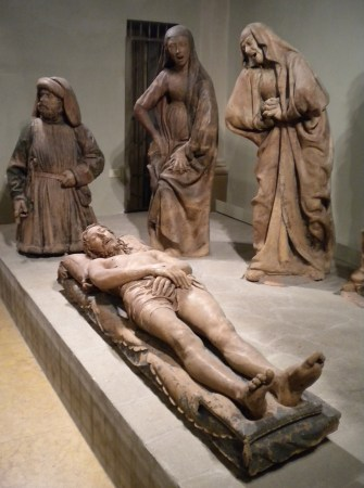 The multi-piece sculpture of the Lamentation over the Dead Christ by Niccolò_dell'Arca contains some highly expressive figures.