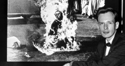 A December 14, 1963 photograph of Malcolm Browne in front of his photo of a Vietnamese Buddhist monk's fiery suicide. AP Photo.