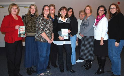Tracy Groot with members of By The Book, Page Turners and the Perry Historical Society.