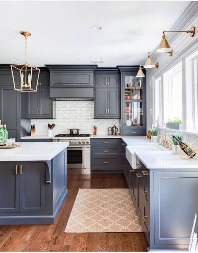 Slate blue kitchen cabinets and brass lighting in this classic kitchen. Come see 36 Best Beautiful Blue and White Kitchens to Love! #blueandwhite #bluekitchen #kitchendesign #kitchendecor #decorinspiration #beautifulkitchen