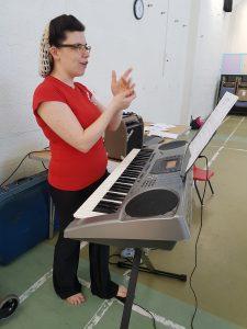 Becki Short explaining a singing technique at a workshop