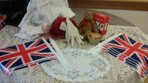 A table set up with 1940's memorabilia at a care home performance from Becki Short