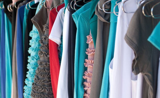 Beckons Yoga clothing on hangers