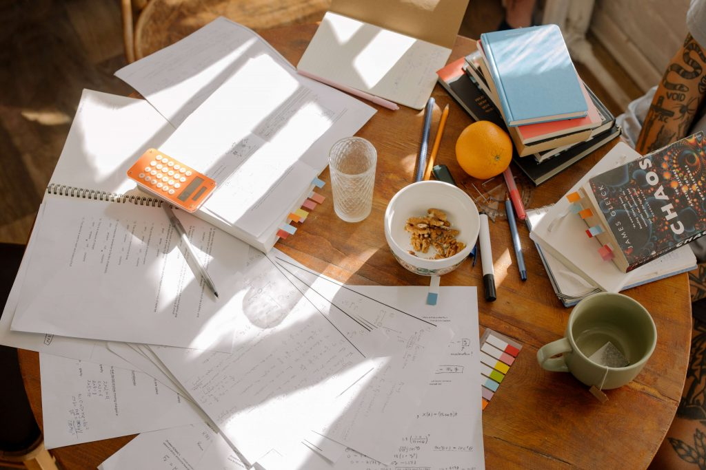 A table with papers and study books