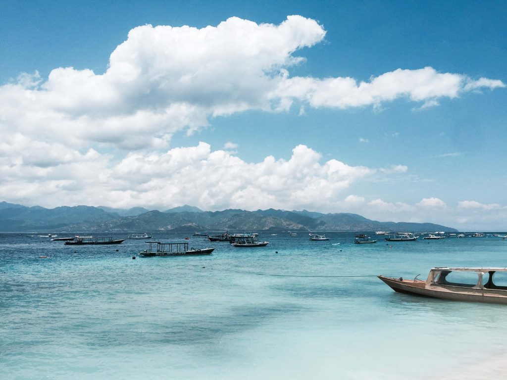 The beautiful waters of the Gili Islands with a couple of boats