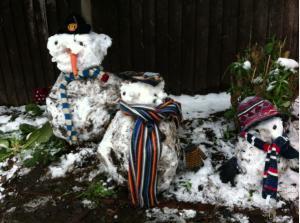 The three grubbiest snowmen in town