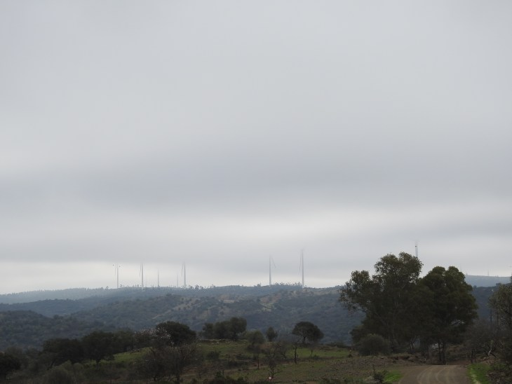 Wind turbines disappearing into the cloud