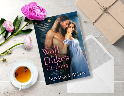 A Wolf in Duke's Clothing flatlay (book, cup of tea, peonies, and envelope and package on rustic wooden tabletop)