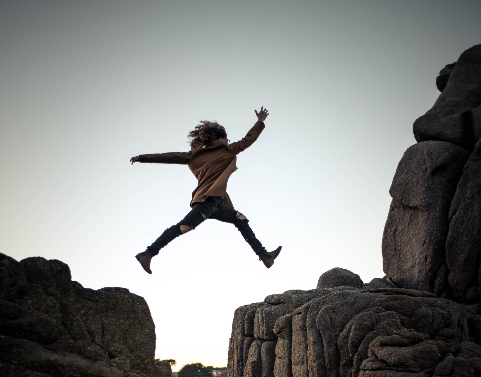 woman jumping over gap with courage