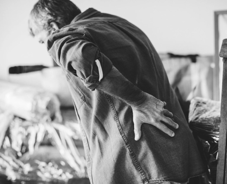 Caregivers are at high risk for back injuries due to using improper body mechanics when moving family members.