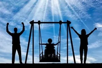 Child with muscular dystrophy swinging